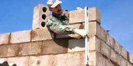Фото - Строительство дома своими руками из шлакоблока – от песка и цемента до готового здания