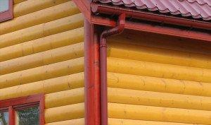 На фото - отделка дома металлосайдингом блок-хаус, fasadportal.ru
