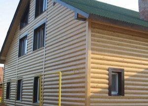 На фото - отделка фасада здания металлическим блок-хаусом, vsestroy74.ru