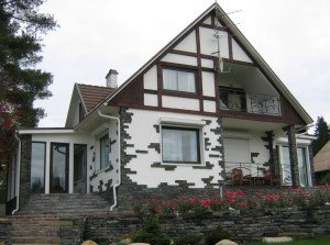 Фото отделки каркасного дома природным камнем, stofasadov.ru