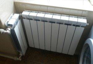 На фото - радиатор отопления для кухни, aqua-rmnt.com
