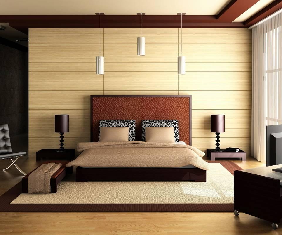 Спальня с коричневой отделкой по контуру потолка и мебелью более тёмного оттенка