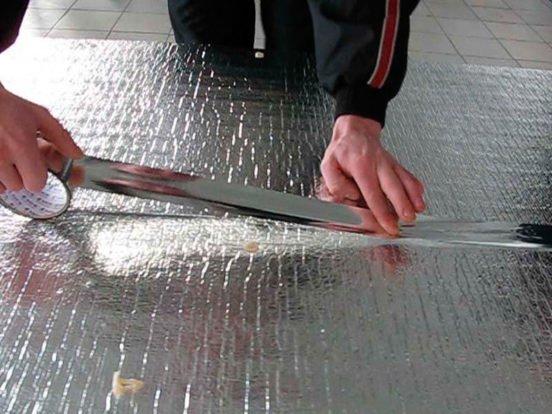 Укладка фольгированного подкладочного слоя
